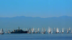 Navy Frigate and Sailing Boats in Front of Mountains Stock Footage