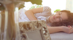 Sleeping woman in her comfortable bed. Slow motion 240 fps. Full HD 1080p Stock Footage