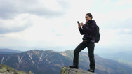 Stock Video Footage of Woman texting on her mobile phone in the mountains HD