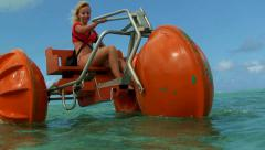 Woman on funny pedalo on a beautiful sea clear water beach resort. Saipan. Stock Footage