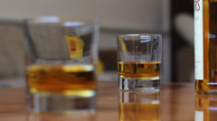 Whiskey in glass and bottle - rack focus Stock Footage