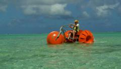 Man on Unusual funny pedalo on a beautiful sea clear water beach resort. Stock Footage