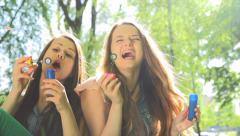Beauty teen girls having fun outdoors. Slow motion video. Full HD 1080p - stock footage