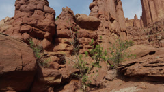 Panning shot of people hiking at Fisher Towers / Fisher Towers, Utah, United Stock Footage