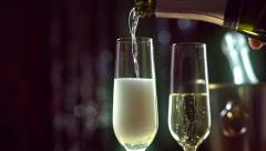 Champagne pouring from the bottle. Slo-mo. Slow motion video full HD 1080p - stock footage