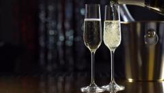 Flutes with sparkling champagne closeup. Slo-mo. Slow motion video full HD 1080p - stock footage