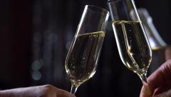Toasting Champagne. Two Glasses with Sparkling Wine. Slow Motion Full HD 1080p - stock footage