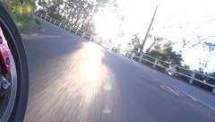 POV Motorcycle low angle lens flares Stock Footage