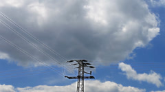 High Voltage Post against blue sky and clouds - stock footage