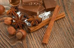 Chocolate,nuts and spice Stock Photos