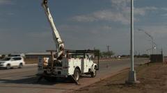 Technician replaces street light 1 Stock Footage