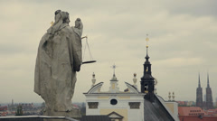 Cityscape of old town in Wroclaw, Poland. Statue symbol of the Faculty of Law. Stock Footage
