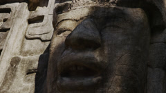 Lockdown close up shot of stone face at Mask Temple, Mask Temple, Lamani, Belize Stock Footage