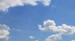 Time lapse of  white clouds over blue sky - stock footage