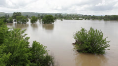 Muddy river flooded countryside after a big storm. Agriculture damage. - stock footage