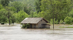 Flooded house. Environmental disaster. Damaged home after big storm and floods. - stock footage