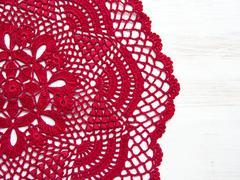 Red crochet doily Stock Photos
