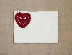 Valentine card with crochet heart - stock photo