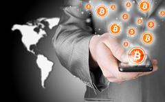 Hand with mobile smart phone and bitcoin symbol Stock Illustration