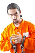 Convicted criminal on white background - stock photo