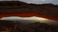 Wide shot, time lapse of sun rising over Mesa Arch, Canyonlands National Park  Stock Footage