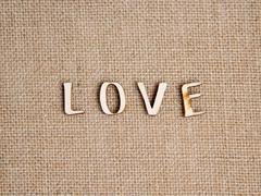 Word love on burlap - stock photo