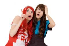 Two amazed servant girls - stock photo