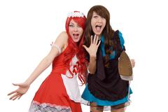 Two shocked servant girls with iron - stock photo