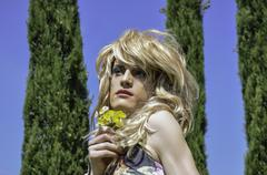 draq queen wearing a wig with flowers - stock photo