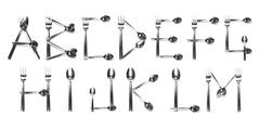 alphabet a - m written with cutlery - stock photo