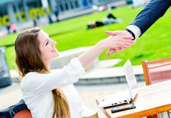 junior executives dynamics shaking hands - stock photo