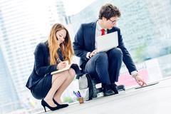 Junior executives dynamics working outside of their office Stock Photos
