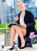 Junior executive dynamic working outside of her office Stock Photos