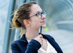 outdoor portrait of a dynamic junior executive thinking - stock photo