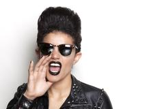 Screaming woman wearing sunglasses and leather jacket Stock Photos