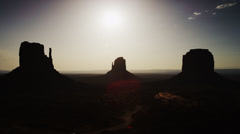 $Wide shot of silhouetted rock formation in Monument Valley  Stock Footage