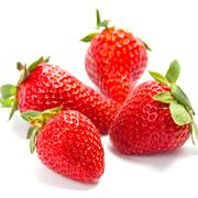 four fresh strawberries - stock photo