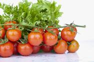 Fresh Cherry Tomatoes and green Salad Stock Photos