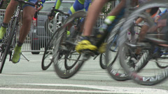 Cyclists turn on the cycle route in Kiev. Slow motion Stock Footage