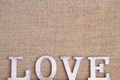 Word love on burlap - stock photo