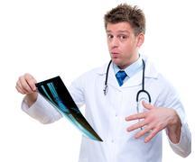 Expressive doctor examining broken foot x-ray Stock Photos