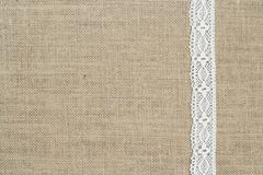 Burlap background with lace - stock photo
