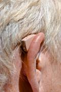 Close-up of hearing aid on the woman's ear Stock Photos