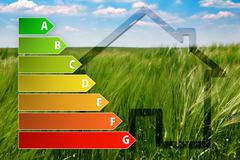 icon of house energy efficiency rating with green background - stock illustration