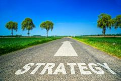 Strategy word painted on asphalt road Piirros