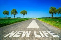 New life word painted on asphalt road Piirros