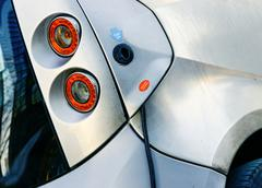 close up on an electric car charge in filling station - stock photo