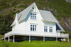 old wooden architecture in norway. white home - stock photo