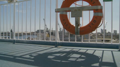 Ferry moving through harbour - dolly in and out Stock Footage