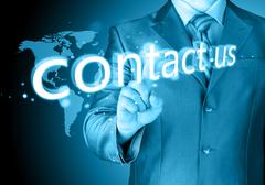 Businessman hand pushing contact us button Stock Illustration